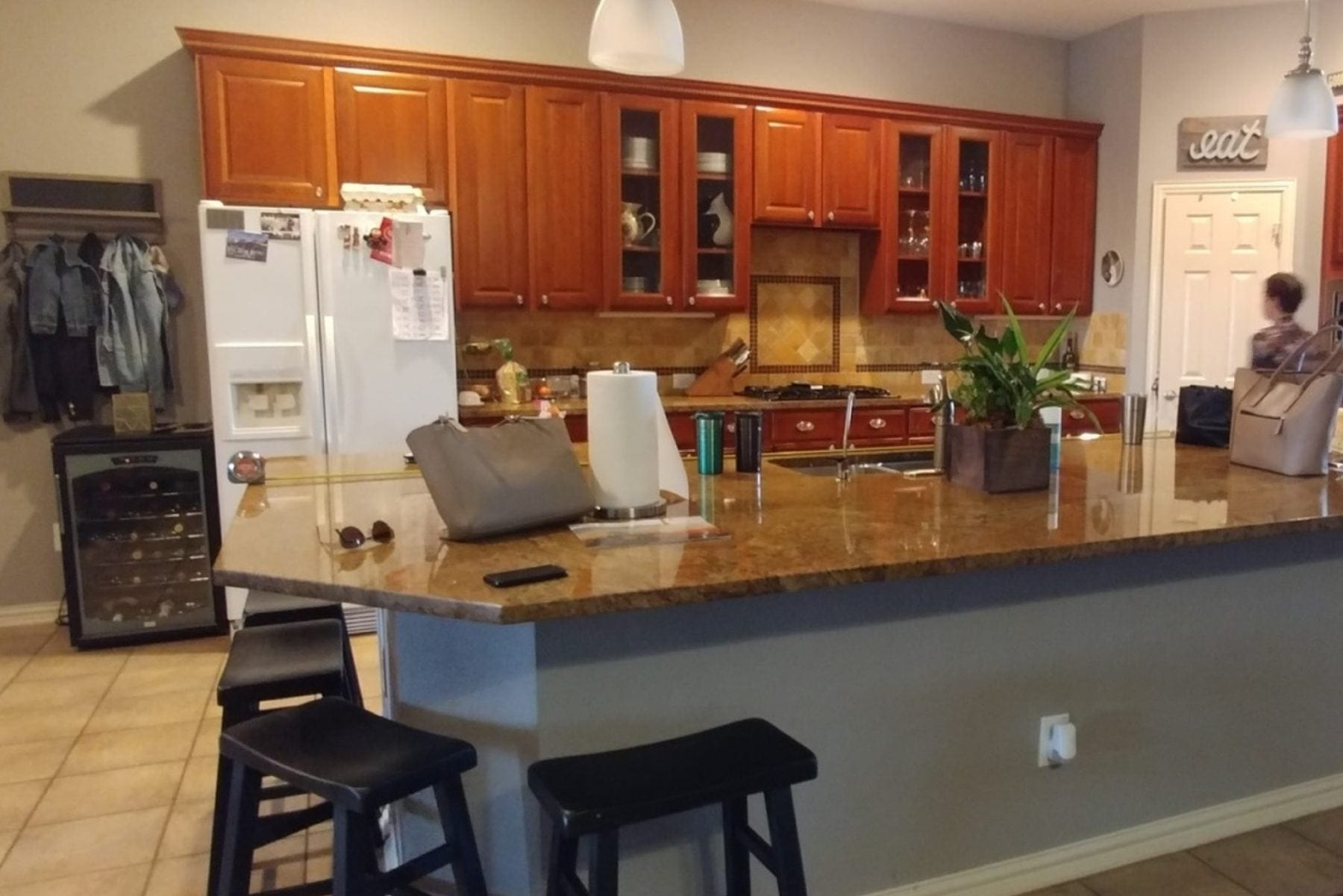 The Owner wanted to change the cabinets, floors,  back-splash, and countertops