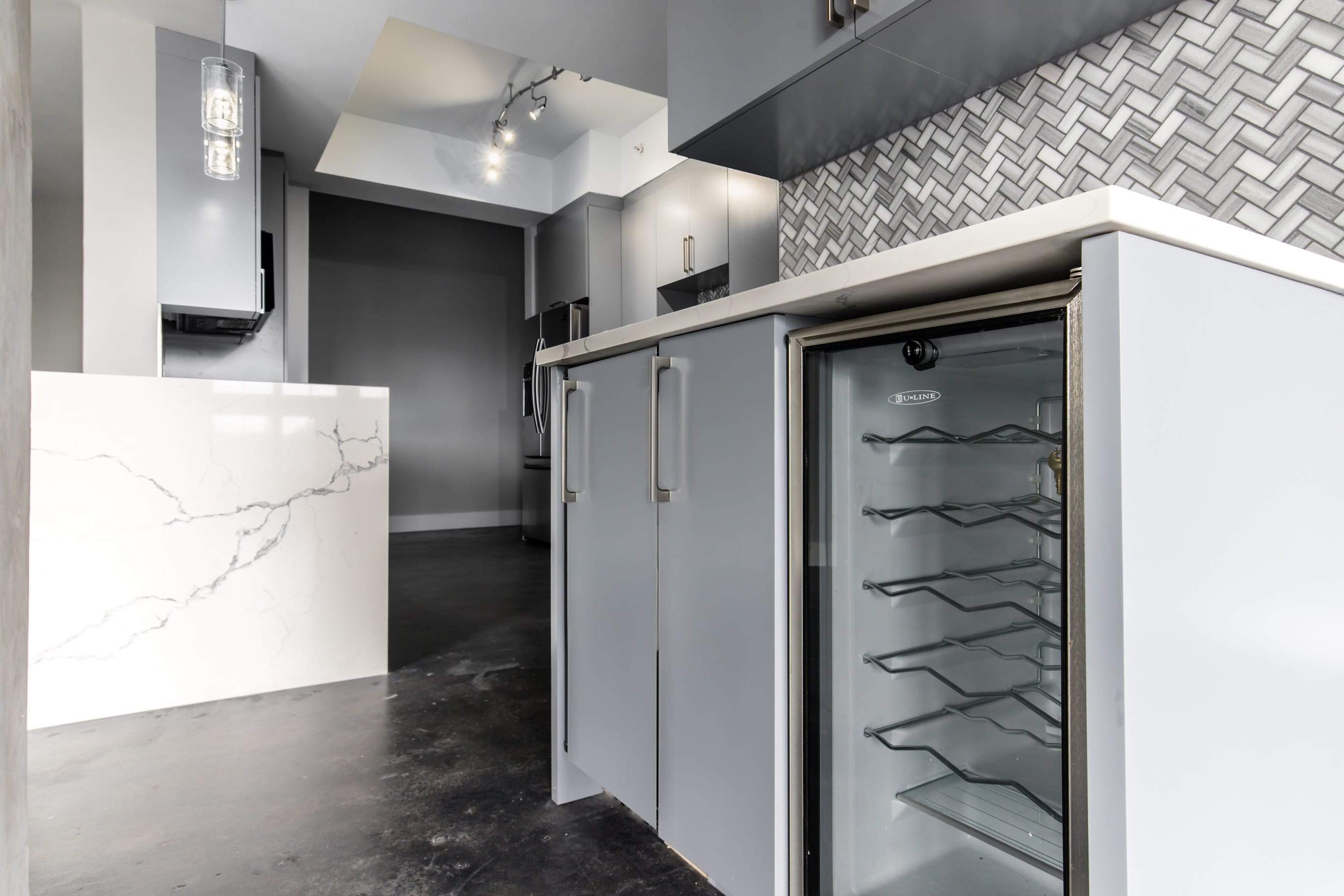 Custom Cabinets Designed with built-in wine coolers and docking stations