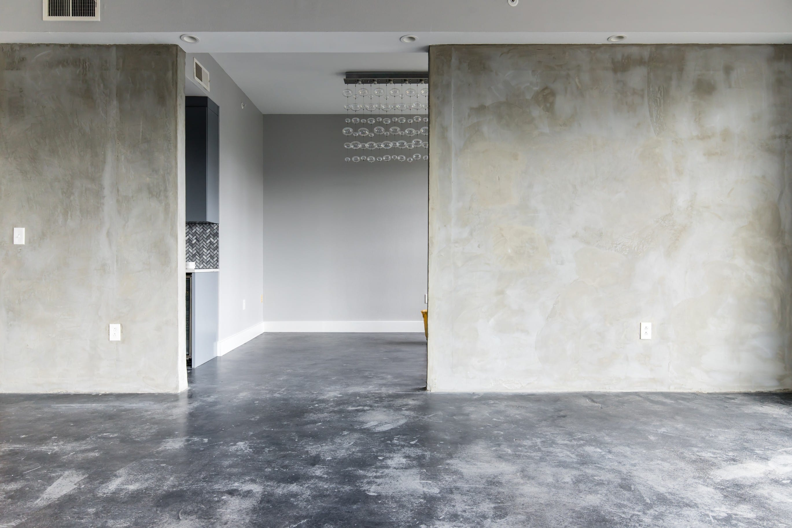 Concrete-Stained-Floors-Skimmed-Walls-Turtle-Creek-Condo-After-Remodeling__1