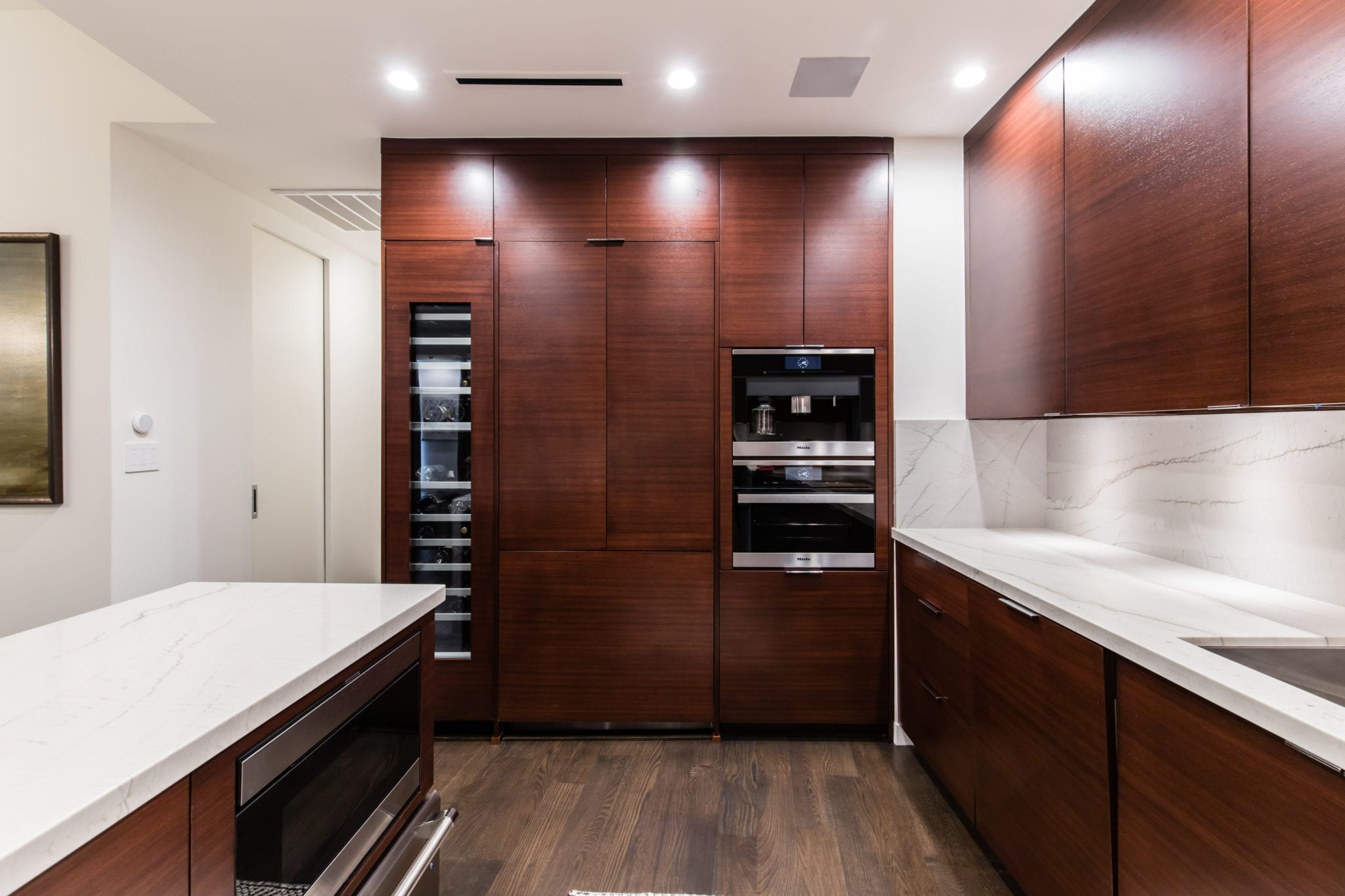 Kitchen-2-story-high-rise-condo-remodel-The-Travis-Katy-Trail-Kitchen-Cabinets-with-panel-ready-refrigerator