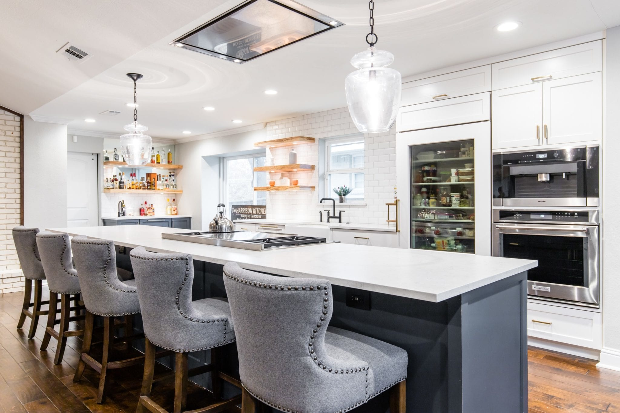 Single-Family-Home-Kitchen-Remodel-Custom-Cabinets-Countertops-Wolf-Stovetop-Faber-Vent-Hood-Open-Shelves-Kitchen-Island-Light-Fixtures-Wood-Floors-HighlandMeadows-75238_1